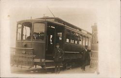 Two Men Standing By Streetcars Postcard