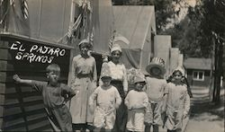 Two Women with Children Standing by Tents, Patriotic