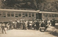 A Group of People in Front of a Train Postcard