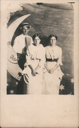 Man and Two Women, Paper Moon Postcard