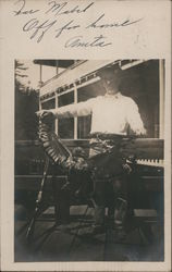 Hunter posing with bird and gun on porch