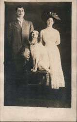 Studio Photo: Man, Woman and Their Dog