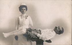 A Nurse Standing Next to a Man who is Lying Down Postcard