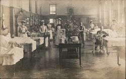 Nurses and Doctors Standing By Patient's Beds at a Hospital Postcard