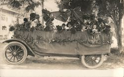 July 4, 1917 open car parade float with children and large flowers Postcard