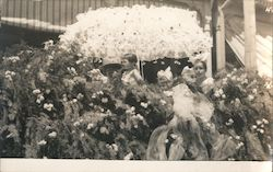 Children on a float with large parasol, pine tree and flower decorations - Summer Postcard