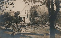 Flood debris in front of a house 1907 Oroville, CA Postcard