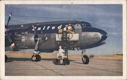 DC-6 Mainliner 300 loading packages Postcard