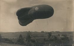 German Blimp over a Field