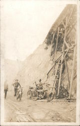 Indian Motorcycles parked under open bridge Postcard