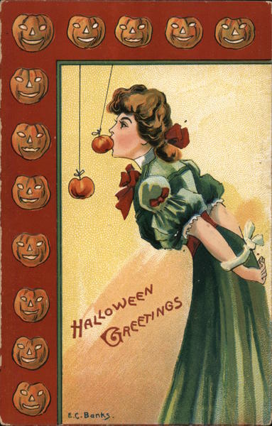 Halloween Greetings. Young woman bobbing for apples. E.C. Banks