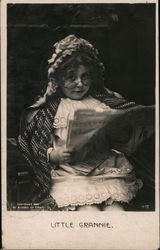 Little Grannie No. 412 Little girl dressed as granny reading paper Postcard