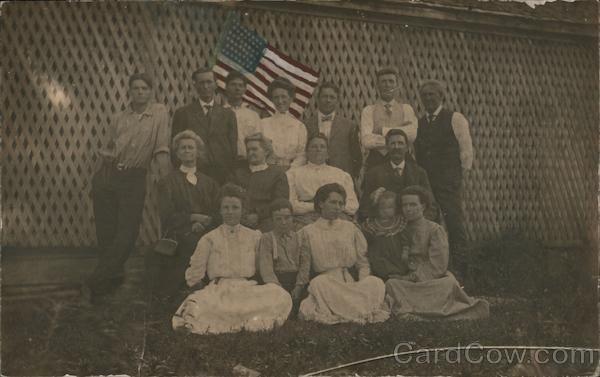 Group of Men and Women Posing with Flag Patriotic