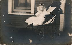 A Baby in a Carriage, stroller