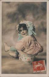 Colorized photo of little girl sitting on chamber pot