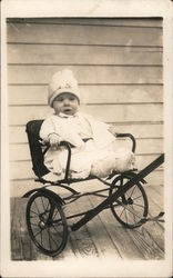 Baby in two wheeled cart