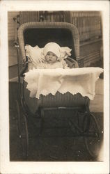 Baby in wicker baby buggy