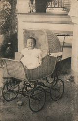 Child in wicker baby carriage