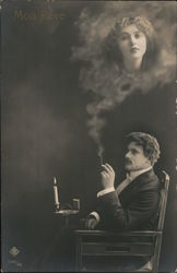 Mon Reve - Man in chair with cigarette and candle; woman's face appears in smoke Postcard