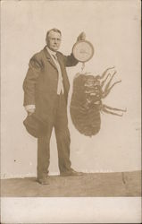 Man holding scale and weighing enormous Flea Postcard