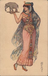 Woman in Egyptian-looking costume, carrying a small elephant statue Postcard