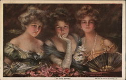 Three ladies in fancy dresses, one with pearls and a fan