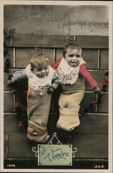 Two Babies Hanging on the Wall in Stockings Postcard