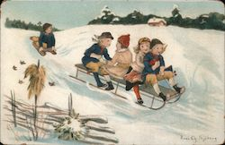 Children Sledding Together in the Snow