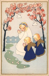 Woman dressed in white, praying, with little angels praying behind her. Flowers & birds overhead. Postcard
