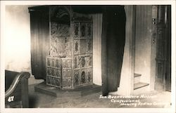 San Buenaventura Mission confessional showing Indian carvings Postcard
