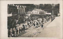 Parade through town, probably California Postcard