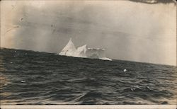 A Large Iceberg Floating in the Ocean Postcard