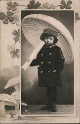 A Happy New Year - Child holds umbrella that resembles mushroom Postcard