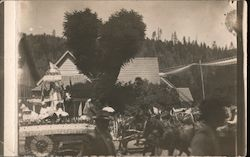 Parade float and a horse-drawn vehicle Postcard