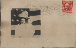 Woman and girl in white dresses, in front of a flag Postcard