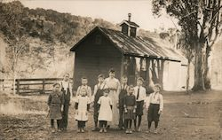 Schoolchildren and Teacher with One Room Schoolhouse Postcard