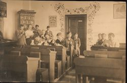 Older students sit in the back of a classroom Postcard