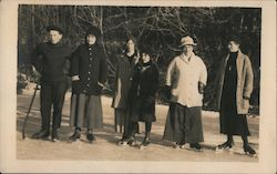 Ice Skaters Pose for a Picture Postcard