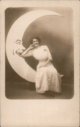 Woman sitting on Paper Moon Postcard