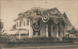 Large house with American flag and buntings Postcard