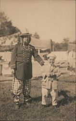 Two Performers in Costume Pose Before Camp Postcard