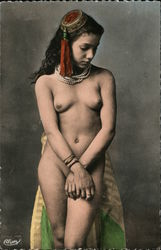 Young naked woman poses with hands crossed looking down Postcard