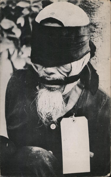 Typical Vietnamese Peasant - Trussed, Blindfolded, Gagged & Tagged
