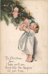 Child Pulls a Kewpie from the Christmas Tree Postcard