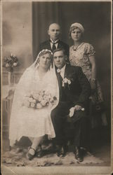A Bride and Groom Standing with Another Man and Woman Postcard