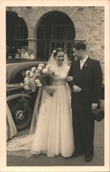 A Bride and Groom Standing Outside a Church Postcard