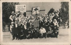 Group of nurses in uniform - Red Cross workers, Cyrillic lettering on sign Postcard