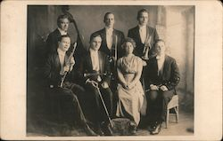 Group Photo of Seven Member Band wearing Formal Clothing and Holding Musical Instruments Postcard