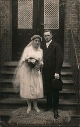 Bride and Groom standing on steps Postcard