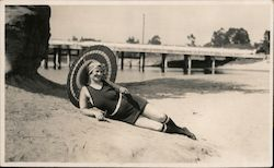 Smiling Woman Posing in Swimsuit with Umbrella Postcard